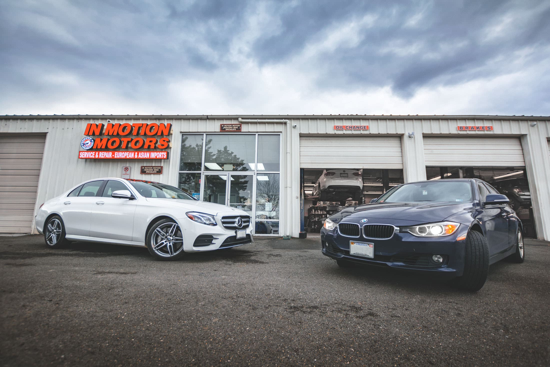 Mercedes and BMW parked at In Motion Motors Auto Repair